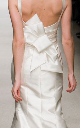 love this. i think i want a dress that is clean and classic, but with an unconventional detail like this.