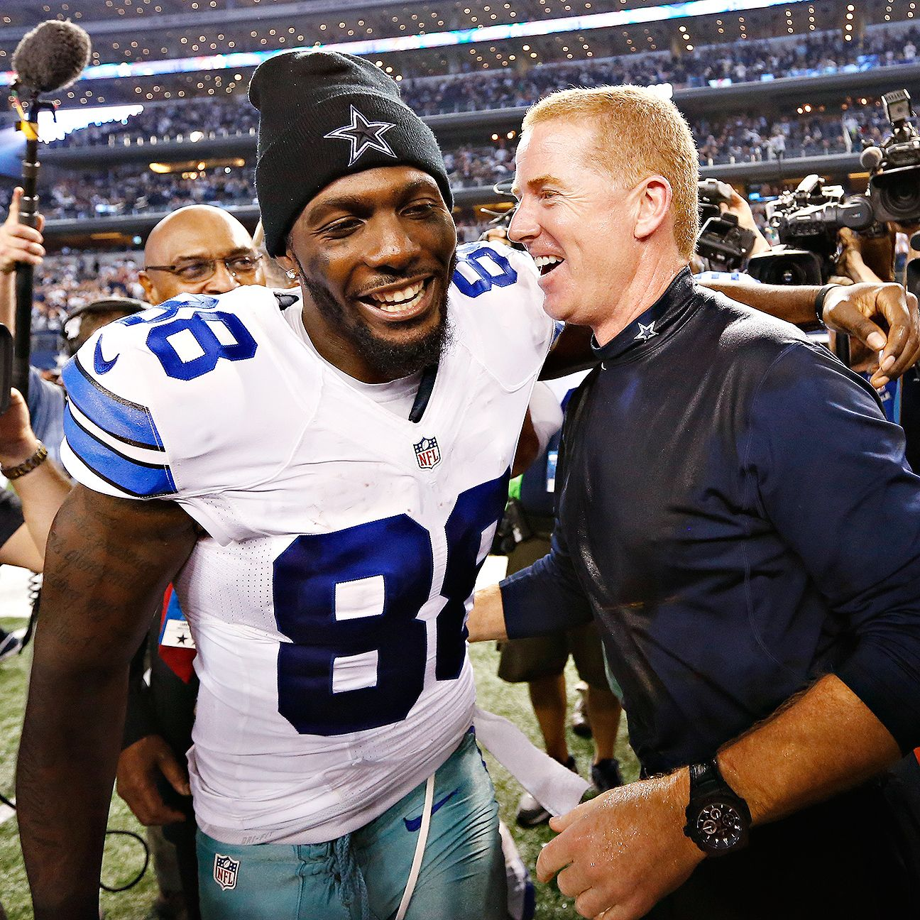 Jason Garrett has had to balance business, football more