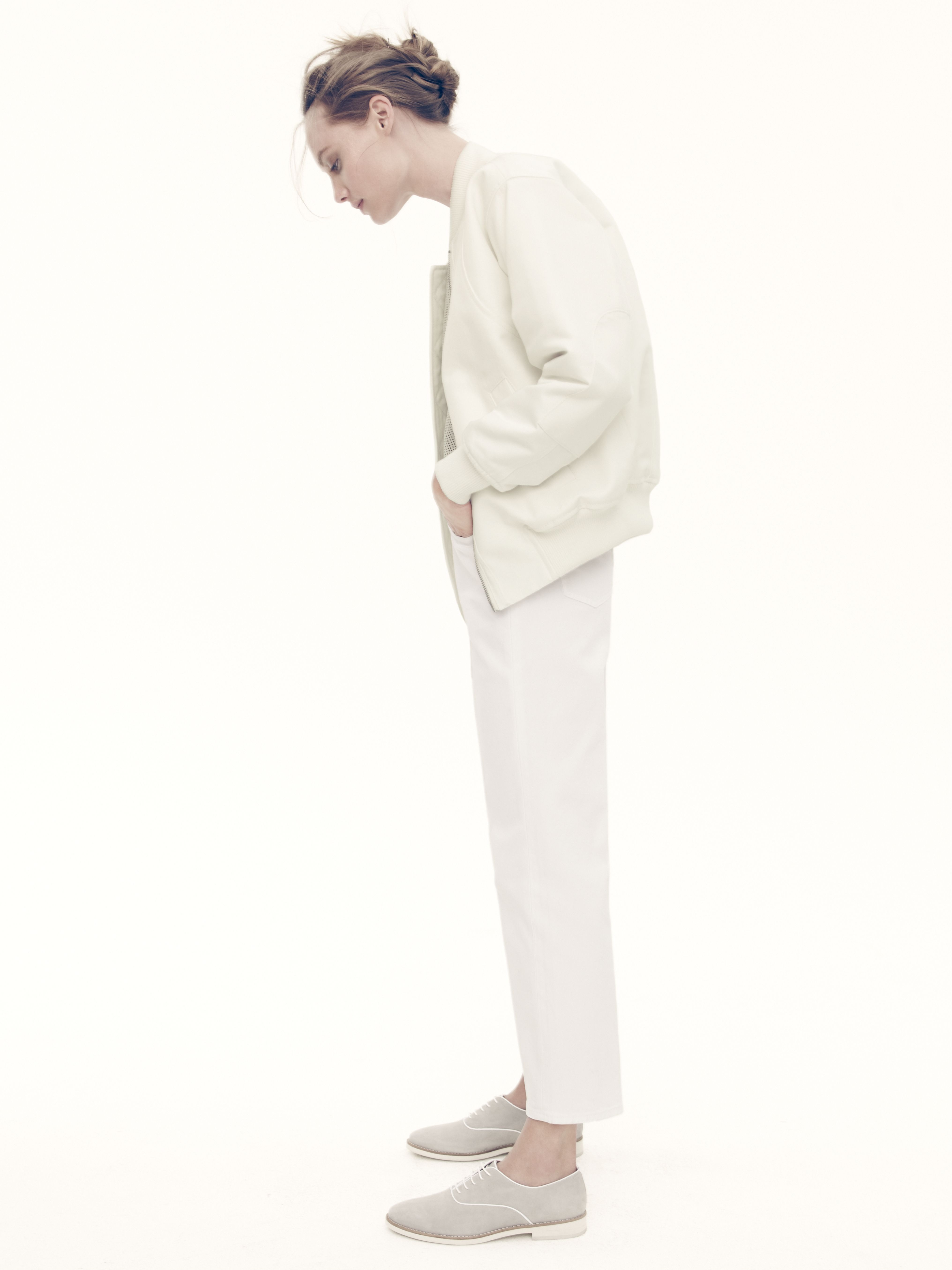 J.Crew Collection cotton bomber jacket, Collection perforated leather shell, wide-leg crop jean in white, and piped suede loafers.