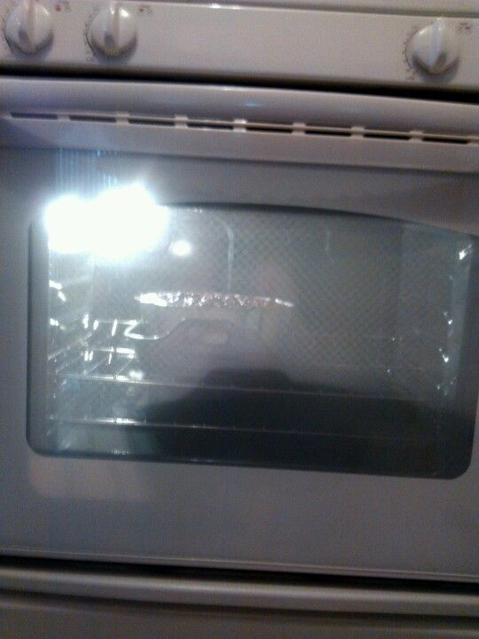 Baking a chocolate flan cake in my new GE oven. Oven will not level so cake is off to left so it will bake properly.