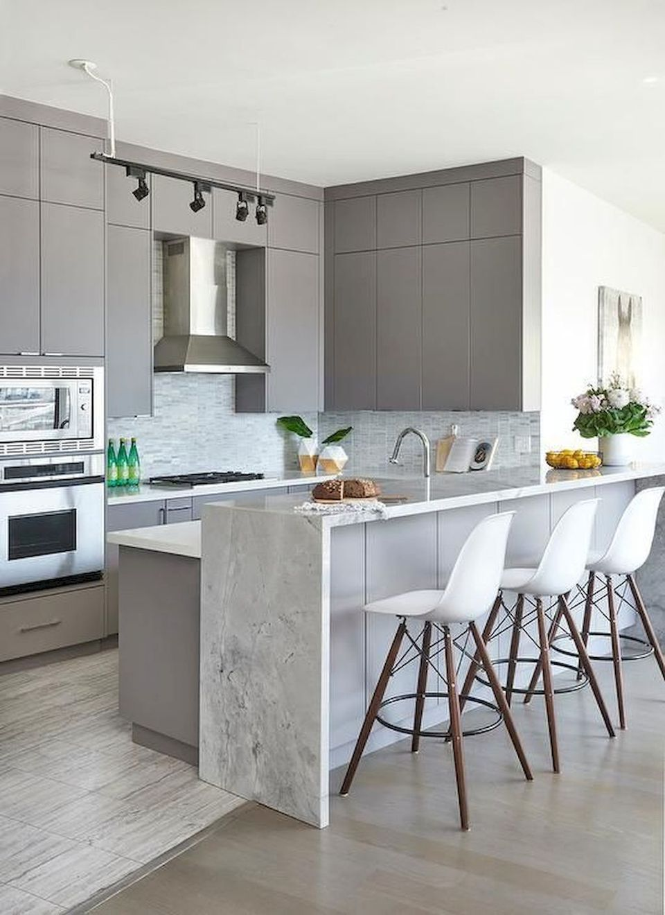 Gorgeous Kitchens With Waterfall Countertops in 2020 ... on Modern Kitchen Countertop Decor  id=76470