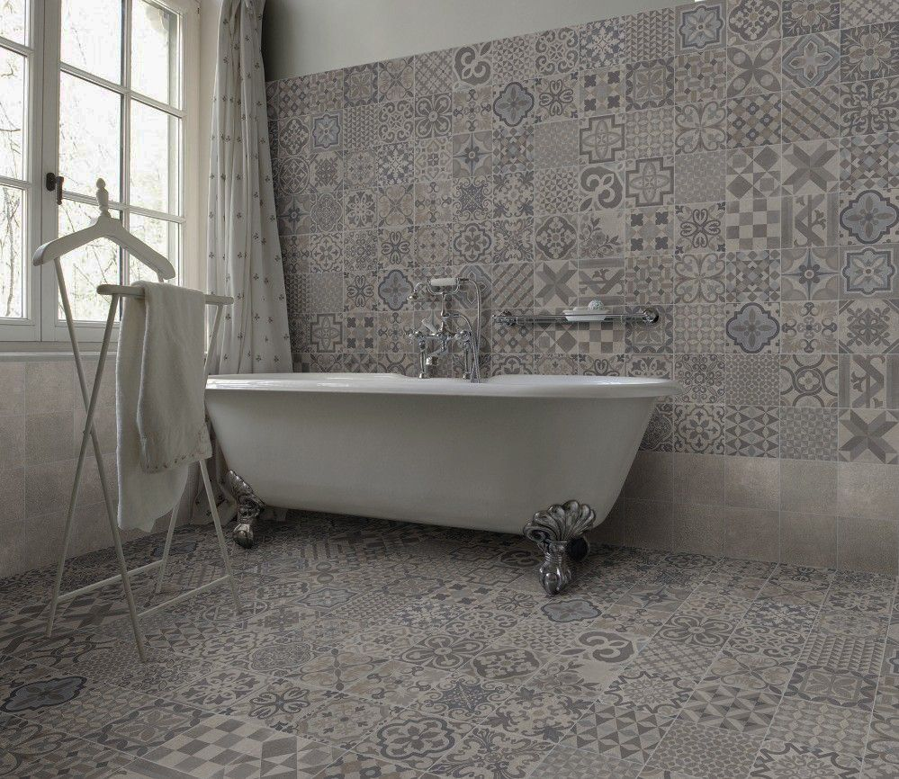 An eclectic design of warm grey patterns a clever mix of for Warm feel bathroom floor tiles