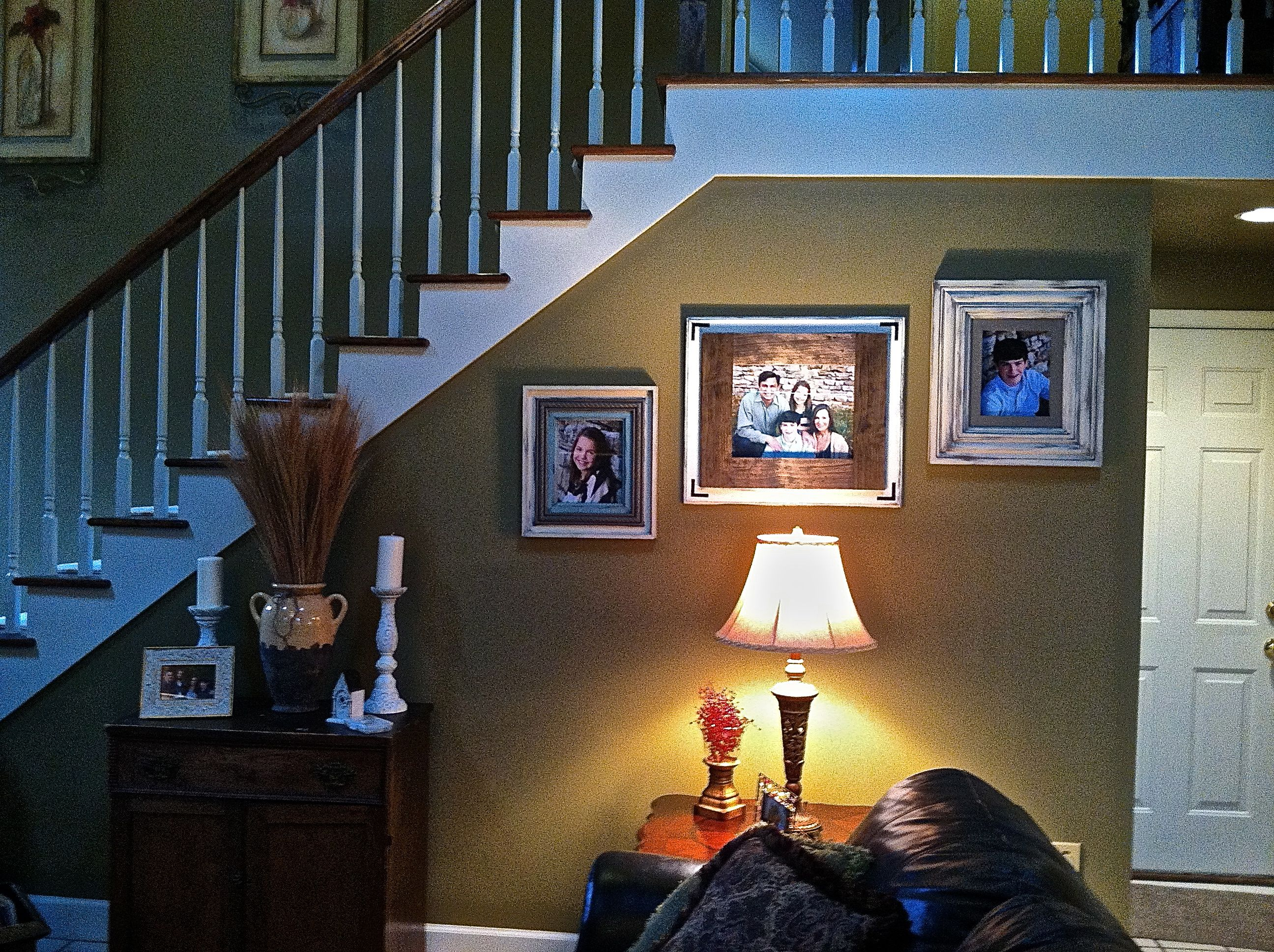 Beautiful family pictures displayed in Kohlston Designs frames.