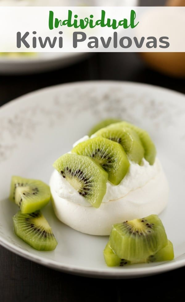 Whip up this easy recipe for Individual Kiwi Pavlovas. They are light, airy, delicate, and require very little effort. #kiwi #pavlova #dessert via @introvertbaker