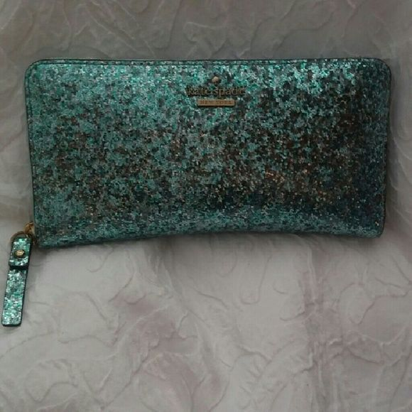 Kate Spade light blue glitterbug zip around wallet Very cute in excellent condition, authentic Kate Spade light blue glitterbug zip around wallet. kate spade Bags Wallets