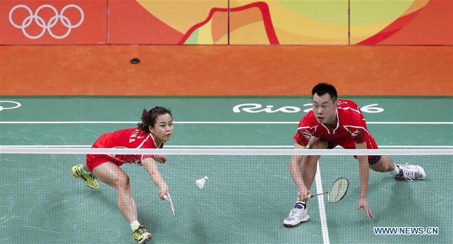 China's Xu Chen (L) and Ma Jin react during a mixed