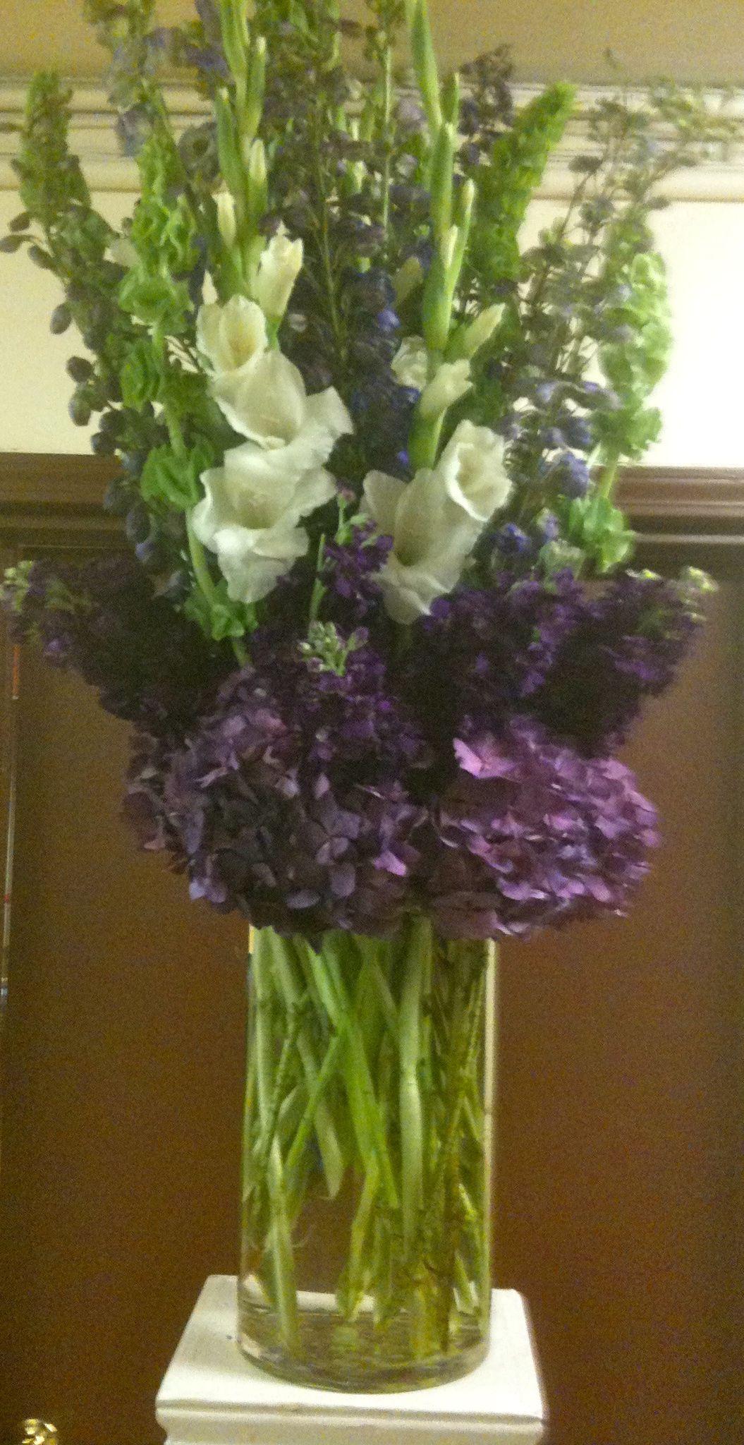 Vertical vase arrangement purple hybrid delphinium bells of vertical vase arrangement purple hybrid delphinium bells of ireland white gladiola with purple reviewsmspy