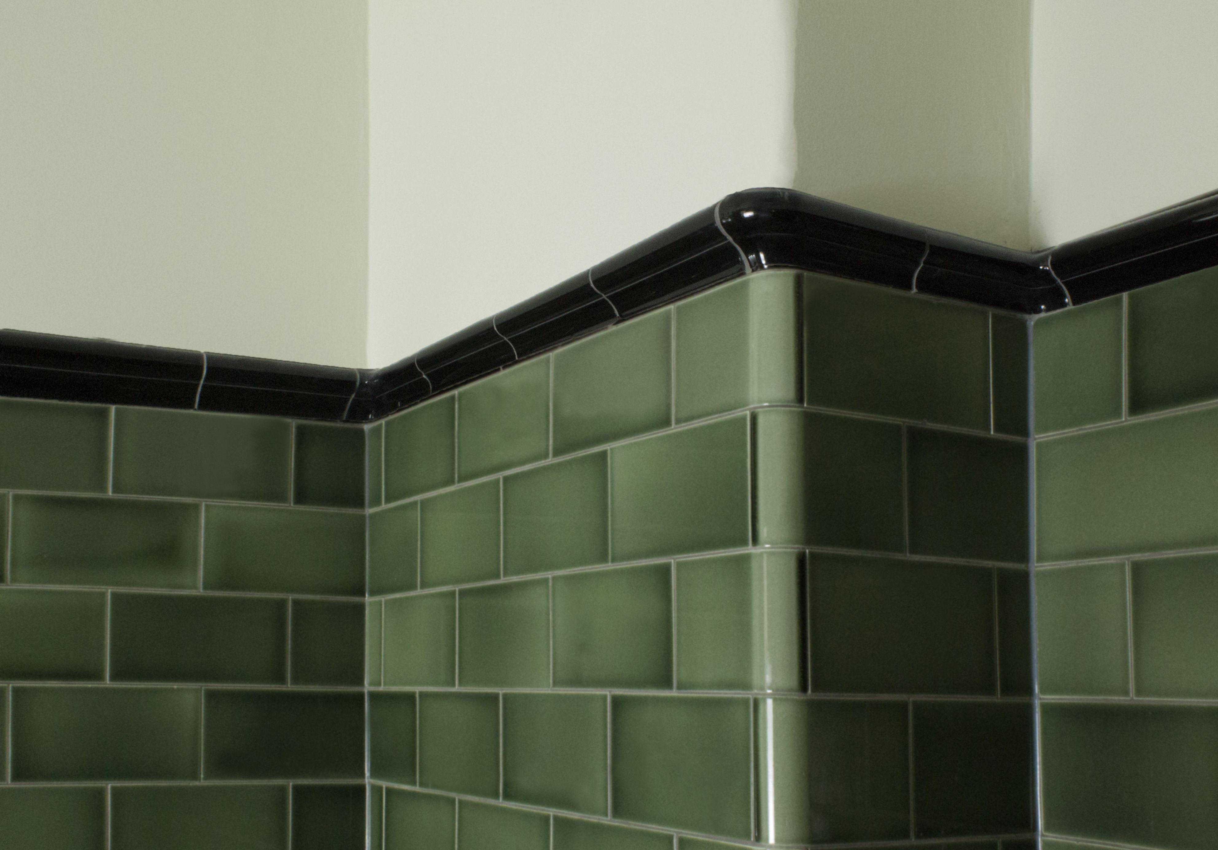 Bold Emerald Green Subway Tile With A Black Border Creates Deep