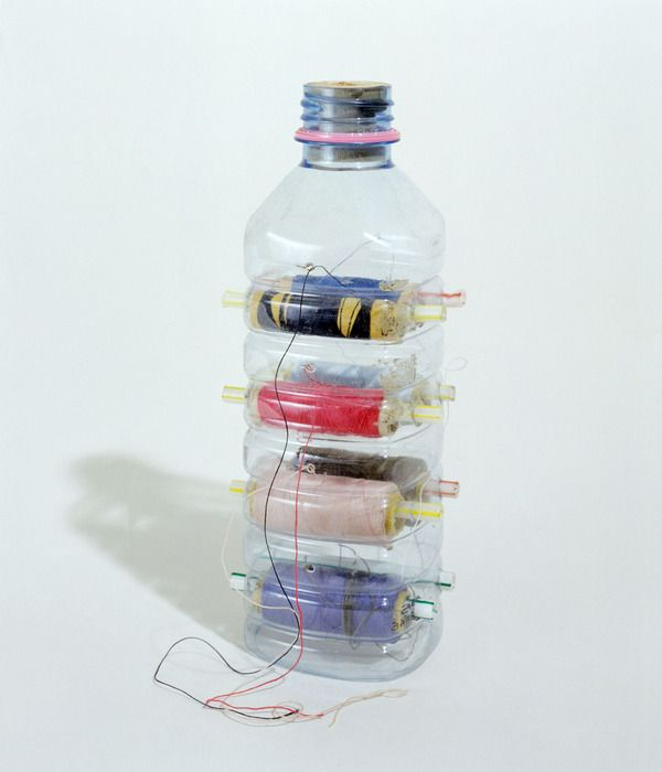 Thread storage in plastic bottle?! Now THIS is thinking outside the box (or bottle in this case).
