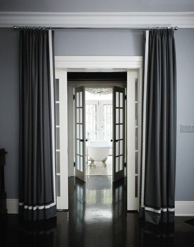 Dark gray Drapes with white wide ribbon banding or edging on leading