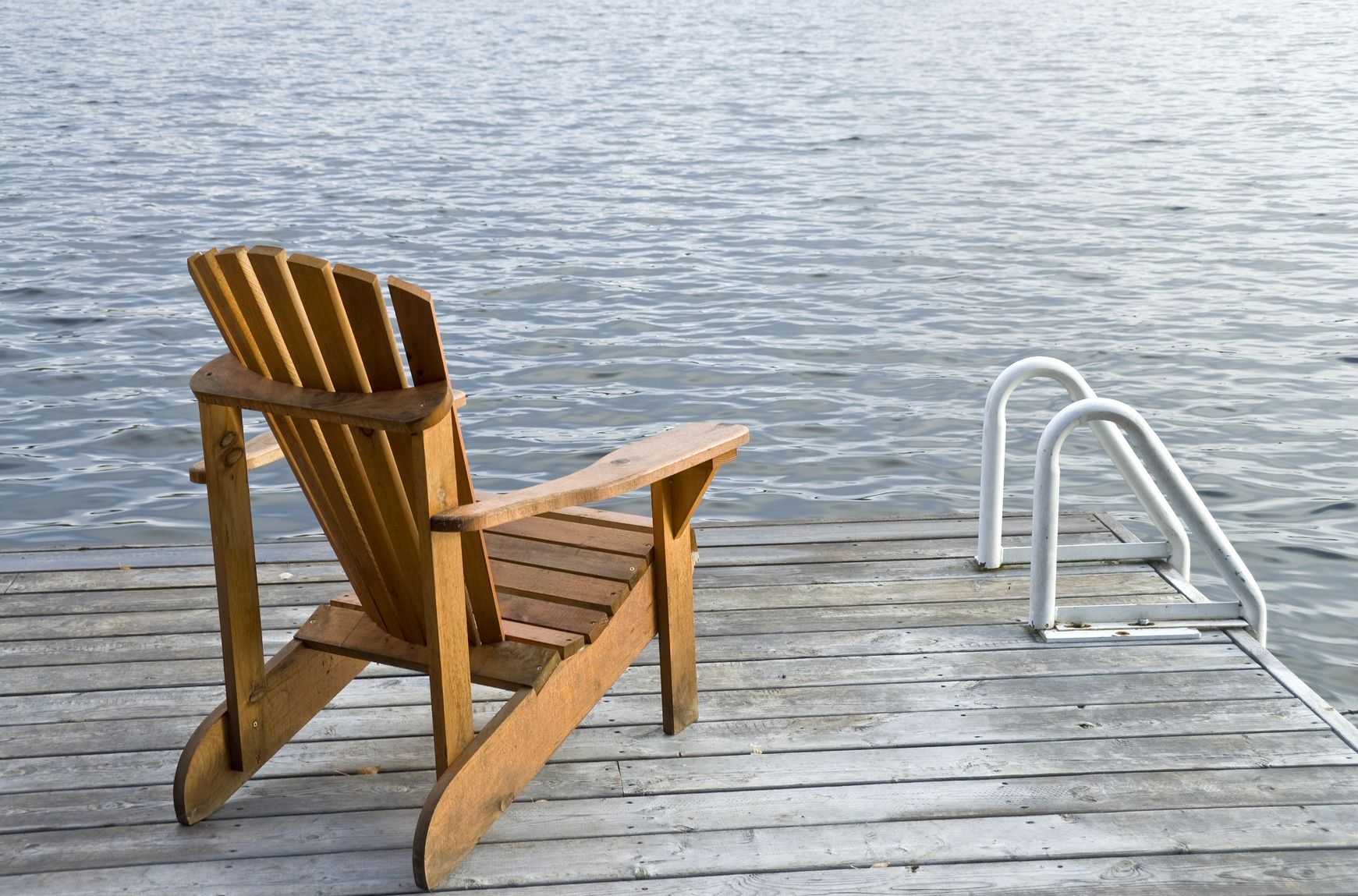 Dock ladder and chair near the river outdoor chairs