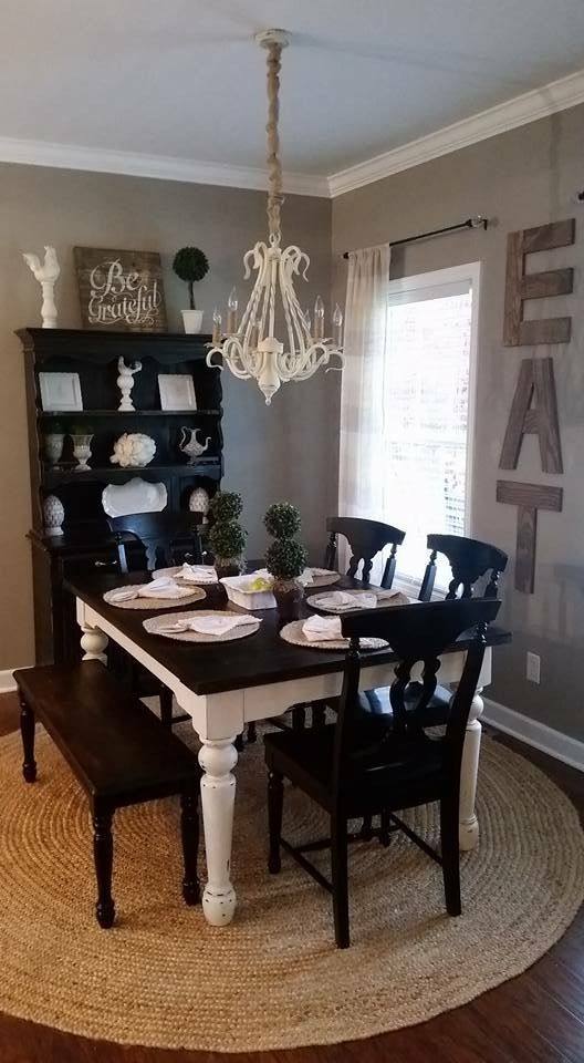 Rustic Farmhouse Dining Room. Home Decor. Chalk Painted Dining Table. Black  Distressed Hutch. Jute Rug. Eat Sign.