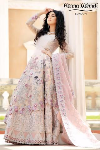 Light pink organza bridal outfit with 3D flower embroidery and heavily encrusted with Swarovski diamante and crystals. Included is a diamante embroidered blouse