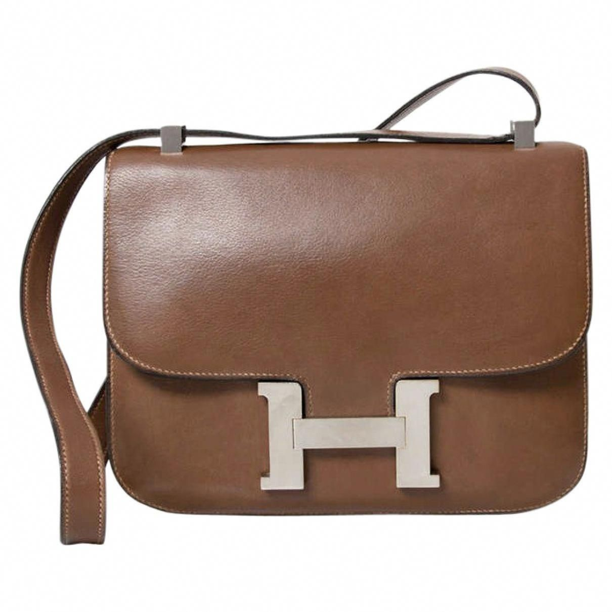 431d2cbfd HERMÈS Brown Leather Handbag Constance | Vestiaire Collective  #Hermeshandbags