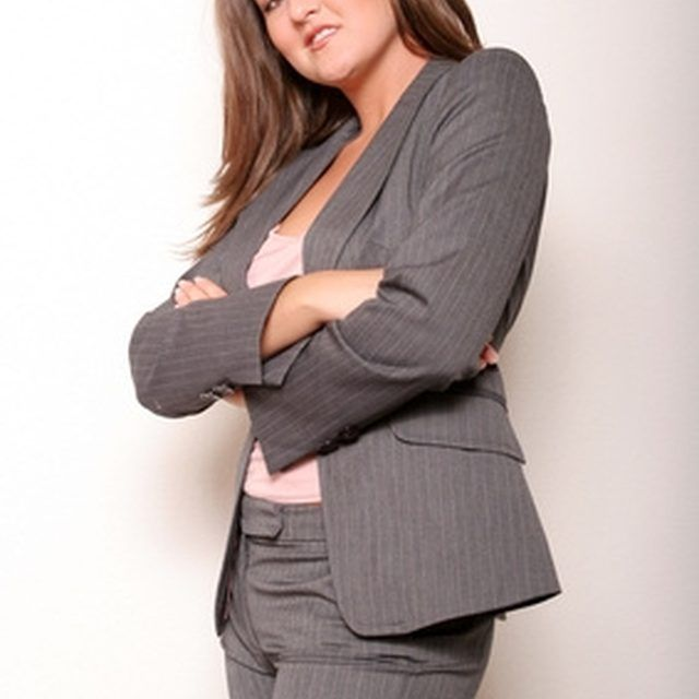 A woman in a suit.