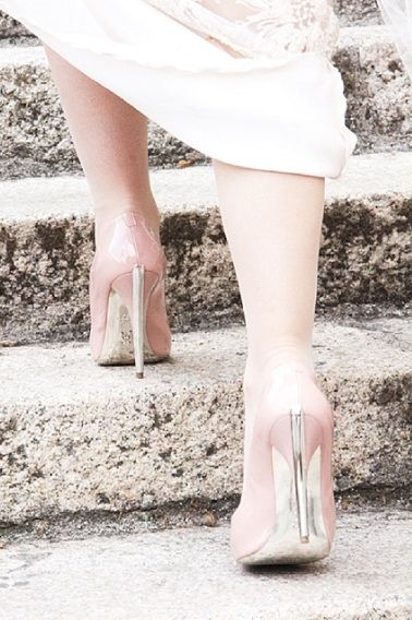 Blush pink patent heels with metallic sole and heels as wedding shoes.