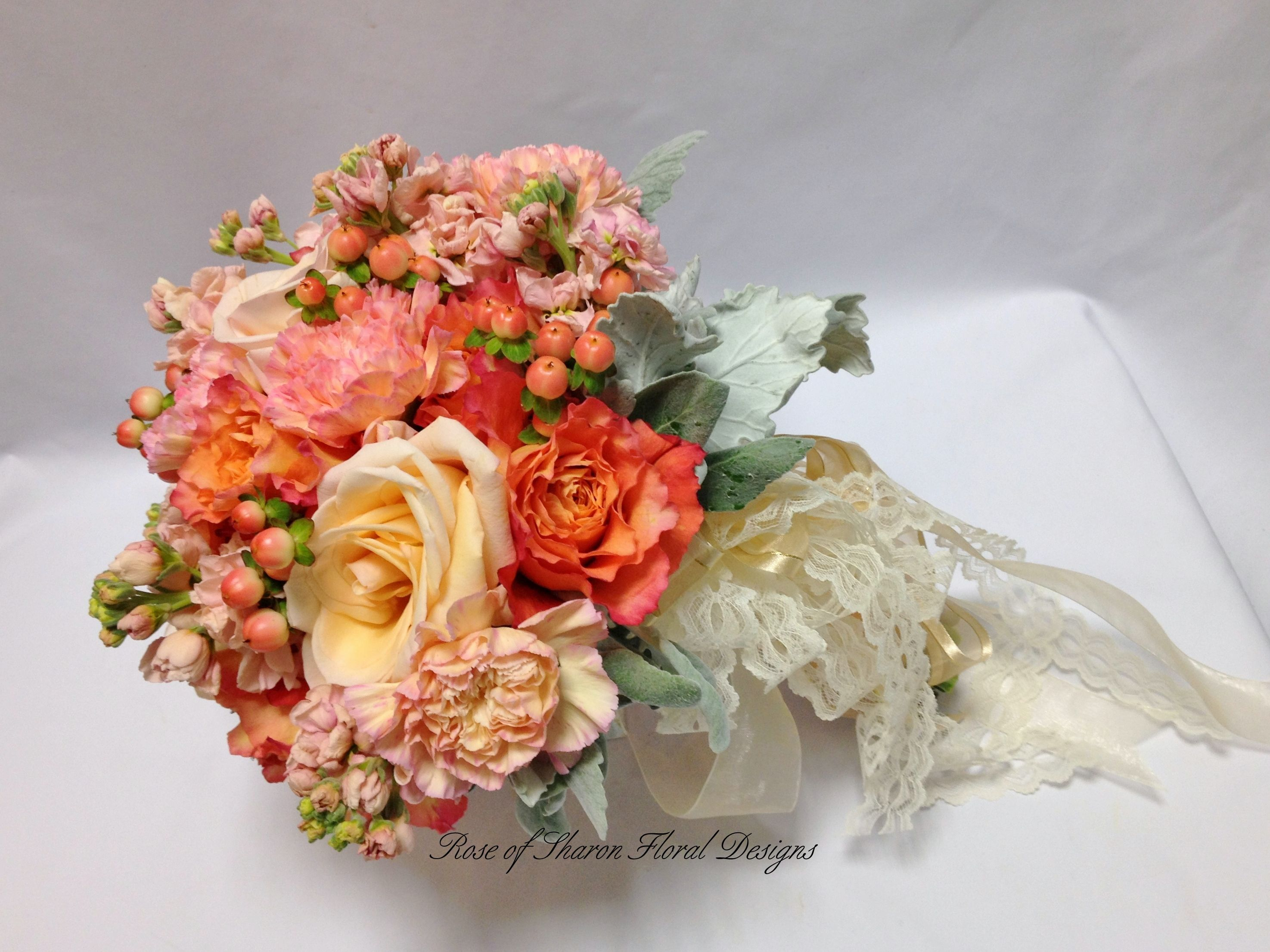Free Spirit roses, peach roses, stock, dusty miller, and