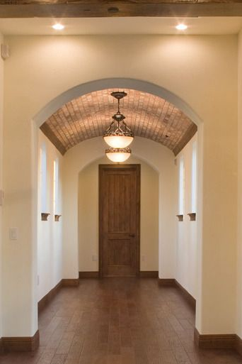 Brick Veneer Single Barrel Ceiling In A Home Designed And