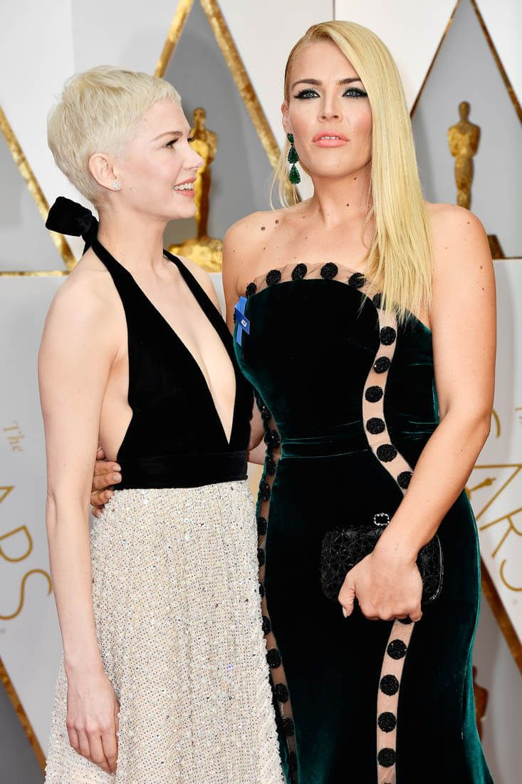 Michelle Williams & Busy Phillips at the 2017 Oscars.