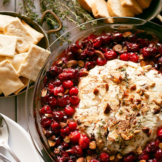 This fancy baked goat cheese roasted cranberry appetizer recipe is easier to make than it looks! It is the perfect appetizer for holiday gatherings like Thanksgiving and Christmas!
