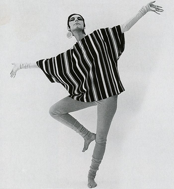 Black-and-white crepe top lined in color worn over unitards.
