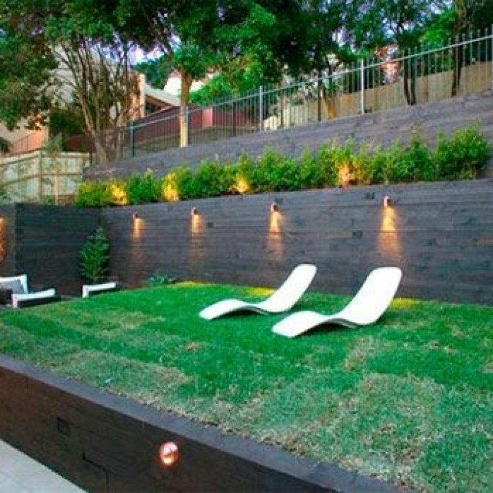 Backyard Kids Play Area Ideas The Steep Gradient Of This Double Terraced Backyard Landscaping Ideas Backyard Landscaping Designs Sloped Garden Sloped Backyard