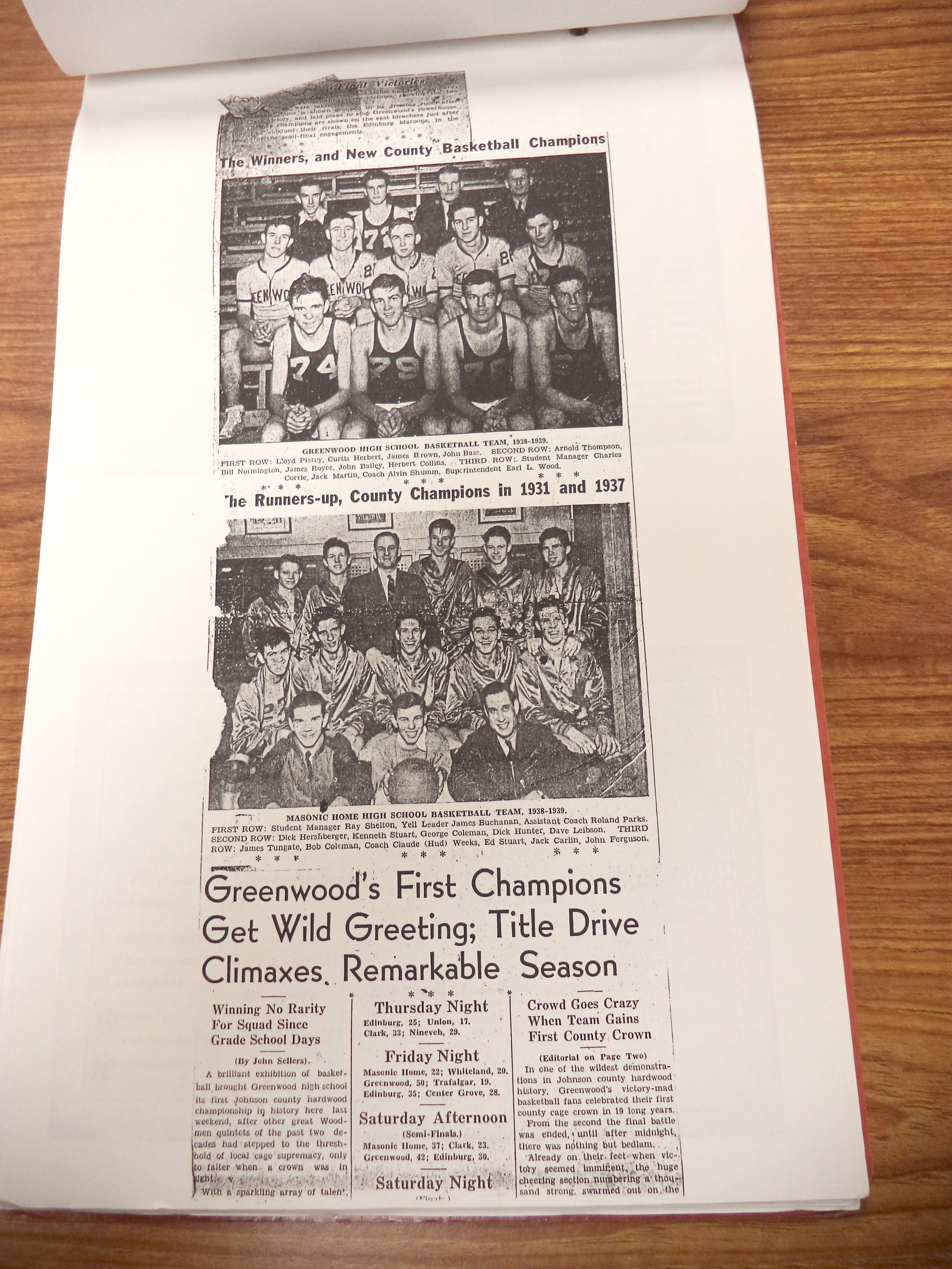 Scrapbook on display in the Johnson County Museum library containing