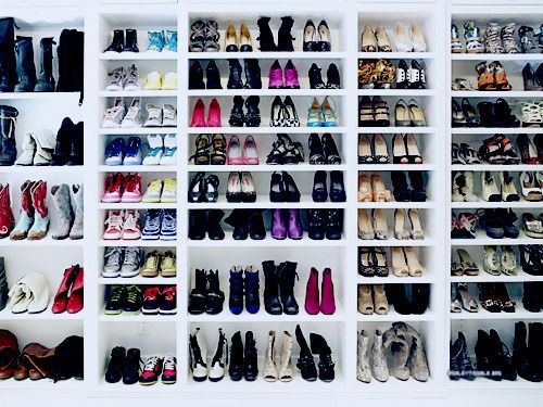 Huge Shoe Rack That Has Shelves At Different Heights So You Can Have Boots  Or Smaller