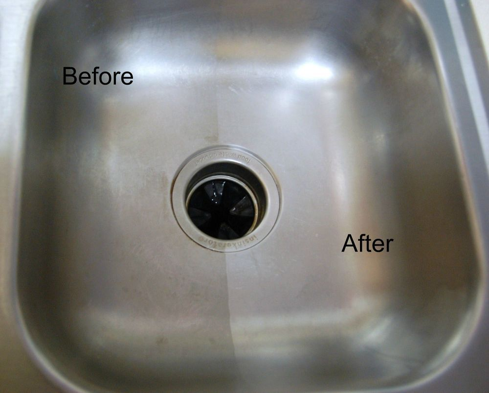 Cleaning A Stainless Steel Sink With Baking Soda And Vinegar With