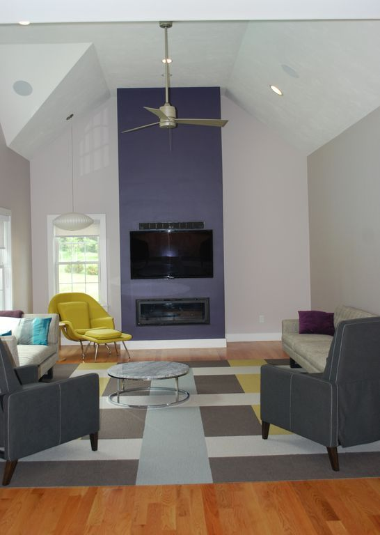 Contemporary Living Room with Ceiling fan, Pendant Light, Hardwood