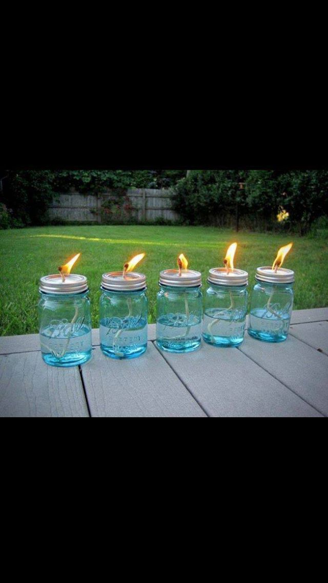Mason jars + cotton strings + liquid citronella = no more Mosquitos! Let string soak for 15 minutes before lighting.