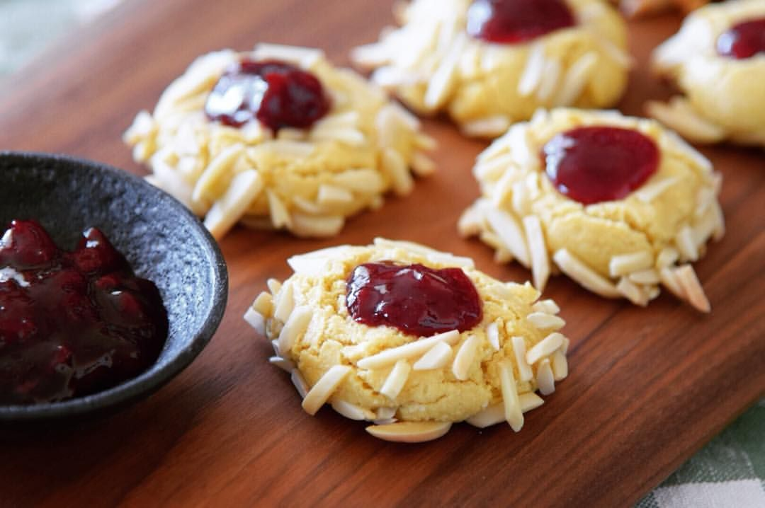 """Laura Brehaut on Instagram: """"Jammy Almond Thumbprint Cookies. Sweetened with a touch of maple syrup and sour cherry jam... Mmm. Another winner from @dollyandoatmeal's Chickpea Flour Does It All."""""""