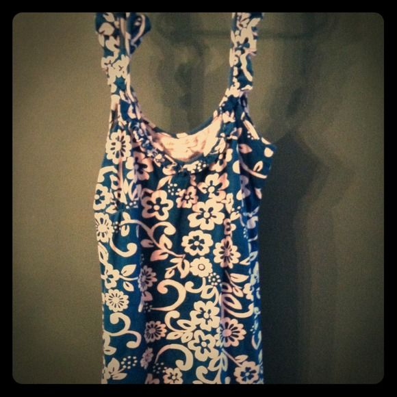 Flirty little summer dress. Teal color white floral design and ruffle straps. Size small. So this could be worn as a dress or as a tunic style shirt. Perfect condition worn maybe 3x Aeropostale  Dresses