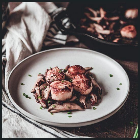 Tender Sea Scallops are sautéed and paired with bacon, shiitake mushrooms, chiv... Tender Sea Scal