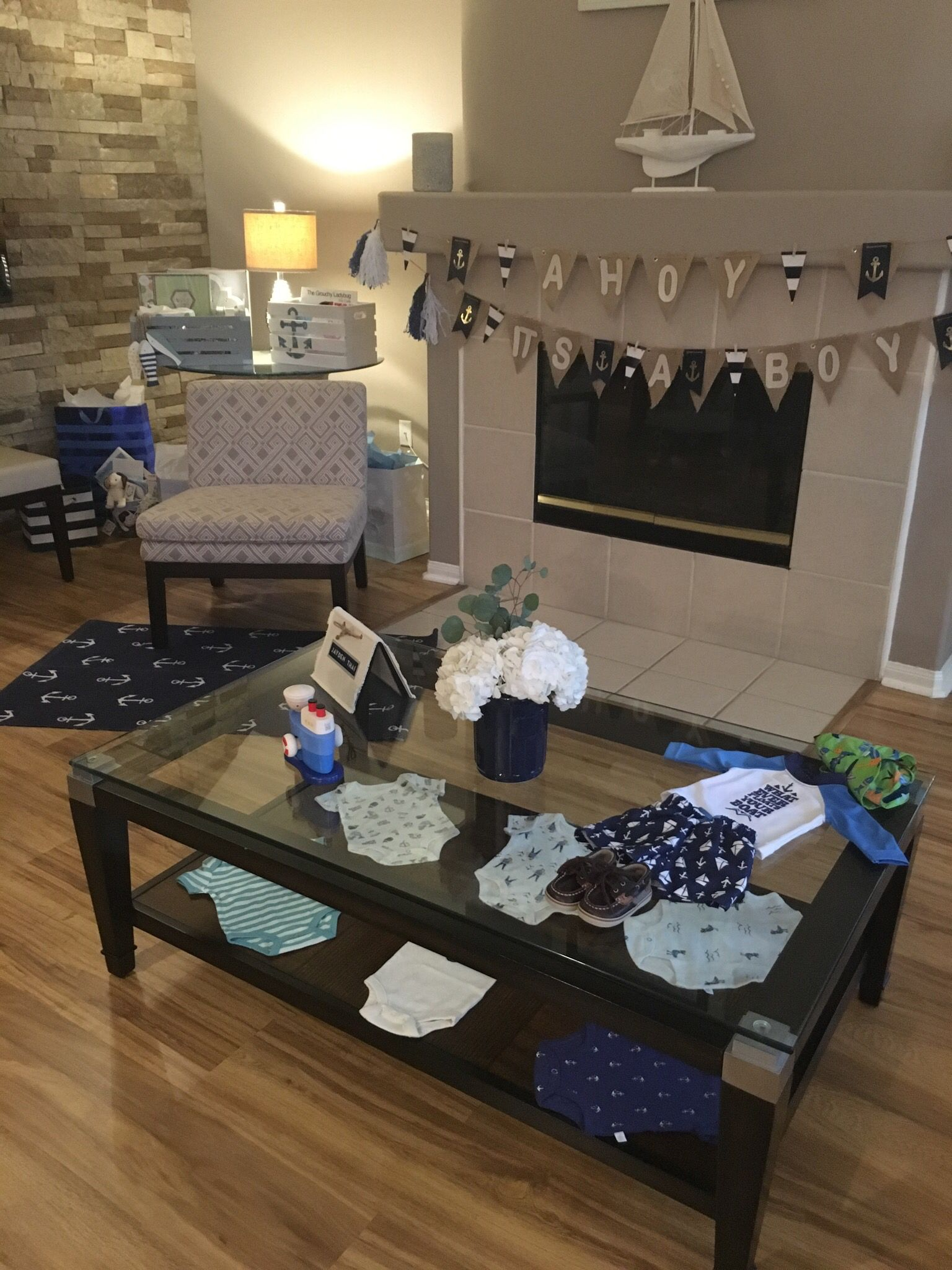 How to display nautical baby clothes with out hanging them.