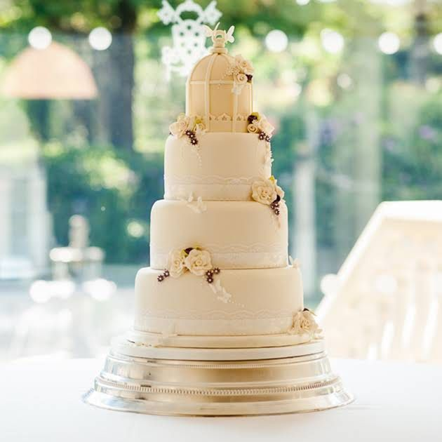 This Cream Colored Confection By Miss Ing Cake Company Is Decorated With A Delicate Birdcage Topper As Well Sugar Roses And Tiny