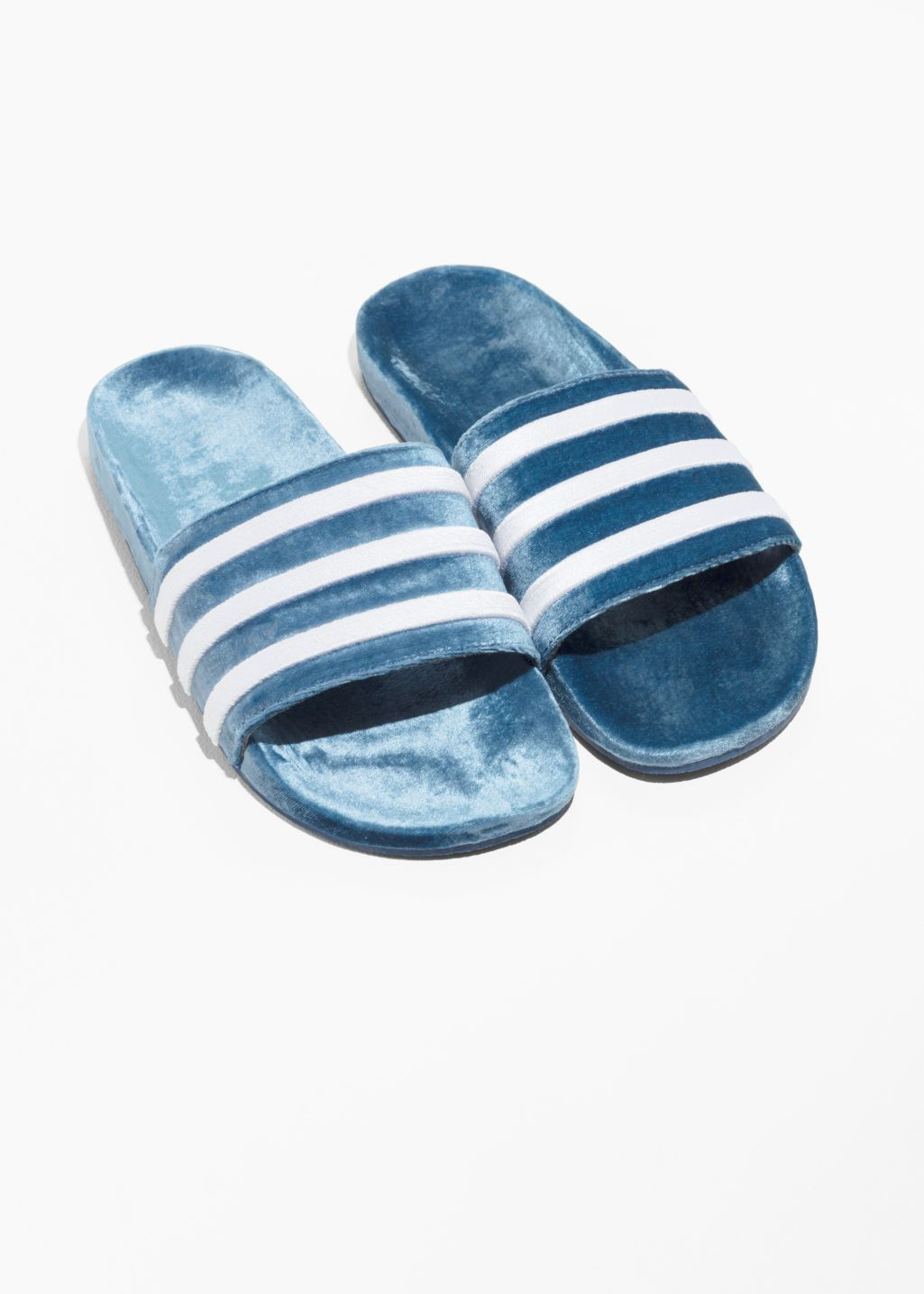 aab5bf321913 Back image of Stories adidas adilette slides in blue