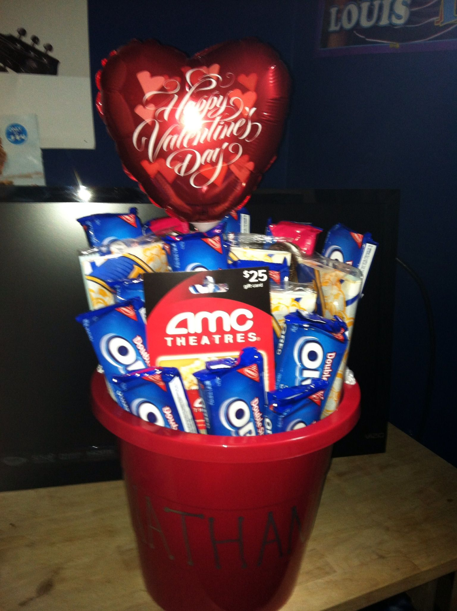 Oreos popcorn and a movies gift card as a Valentines Day gift for