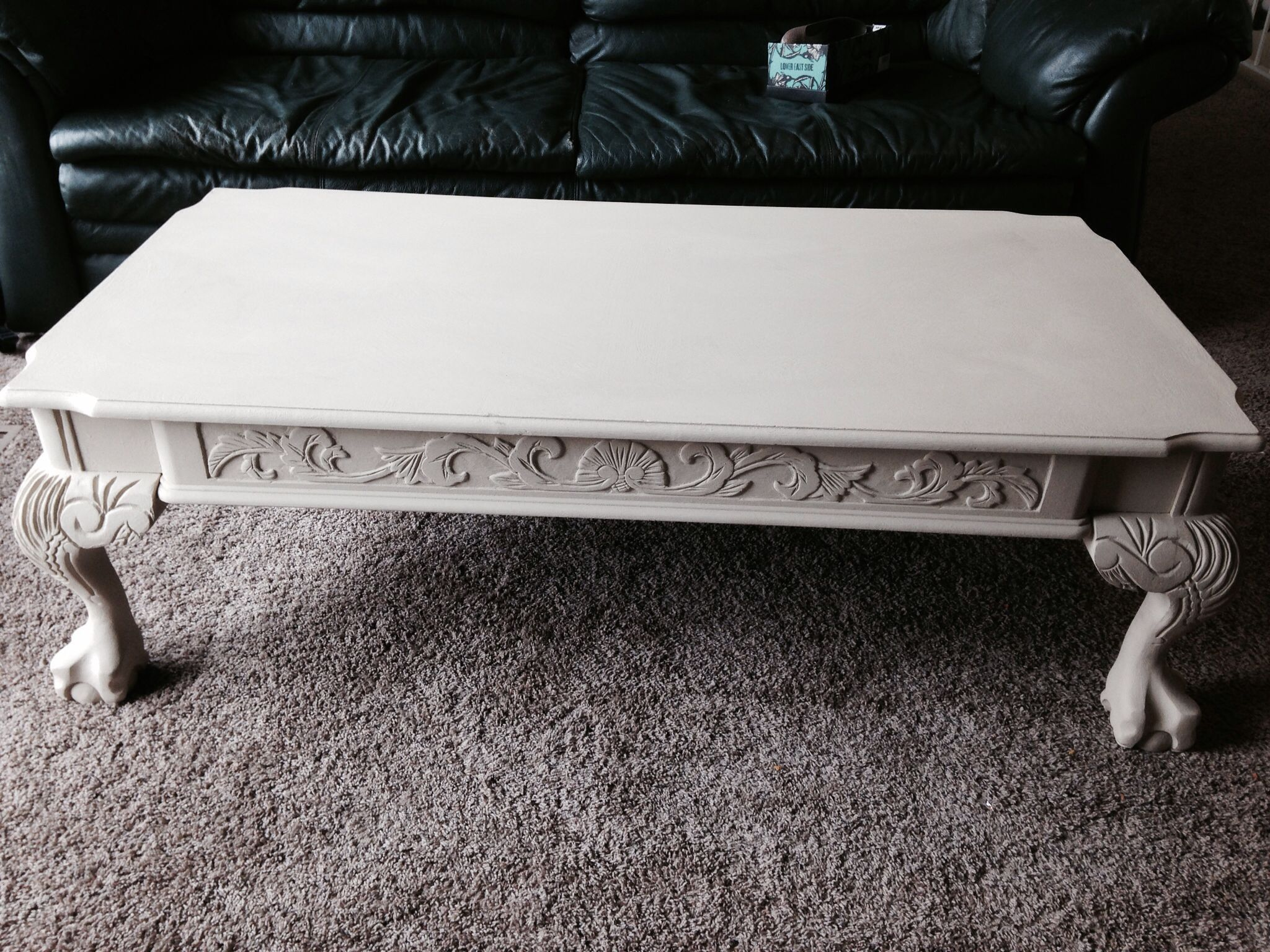 Painted and antiqued claw foot coffee table