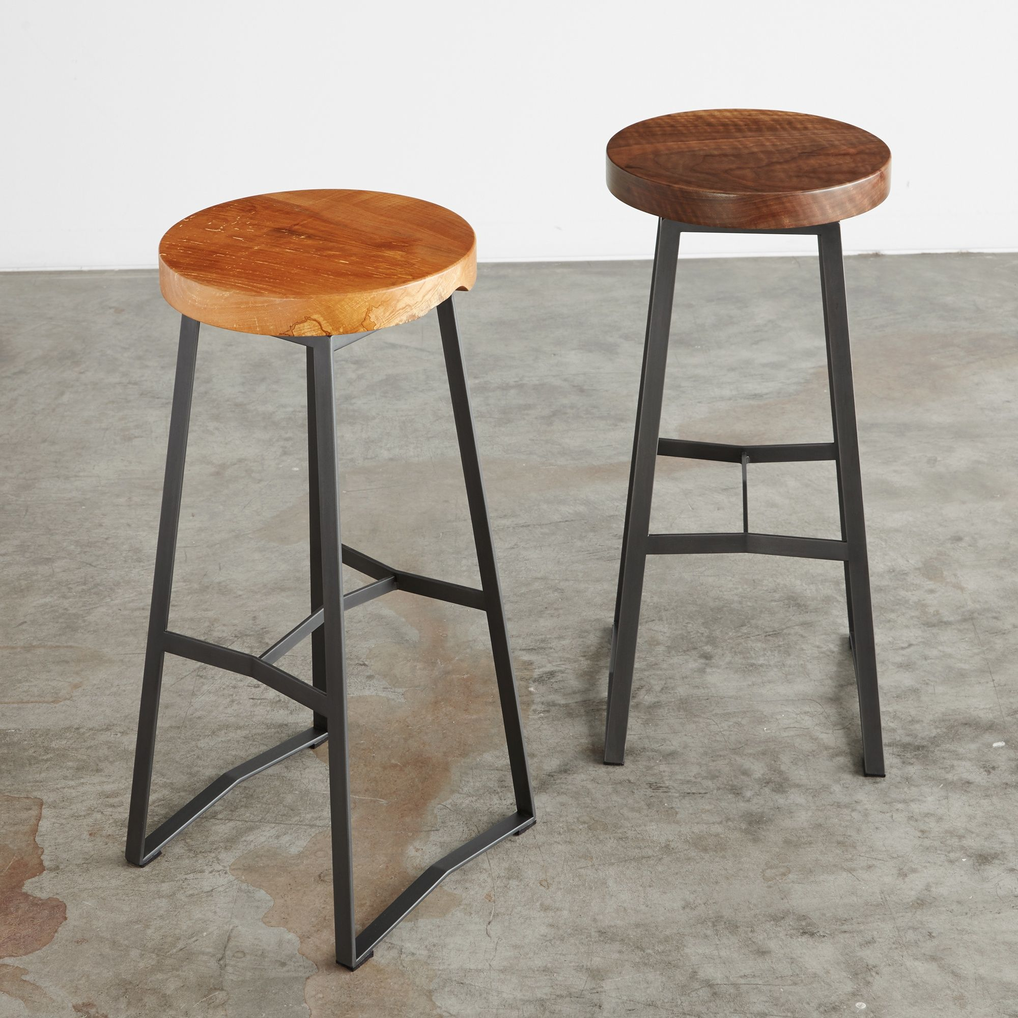 A Round Wood Swivel Seat Sometimes With A Bit Of Live Edge On A