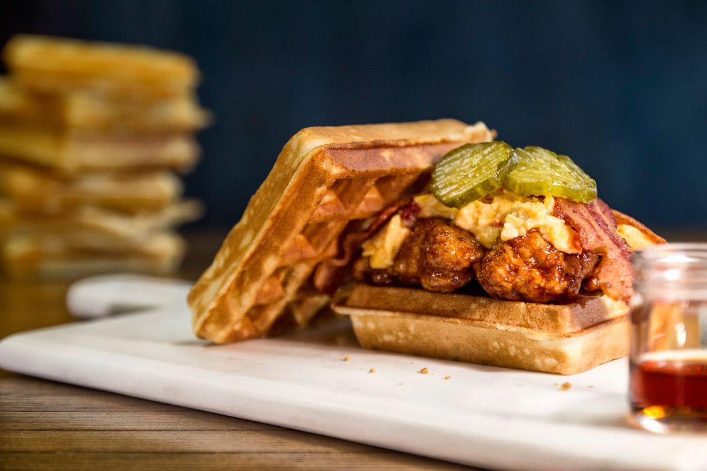 This Chicken & Waffles Sandwich got us grinnin' like a possum eating a sweet potato. #SouthernFood
