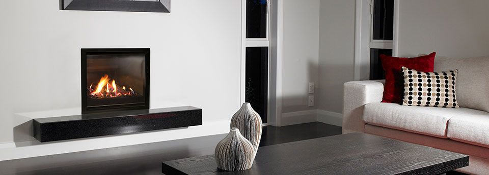 Escea DF700 Gas Fireplace With Volcanic Black Fascia In A Modern Living Room