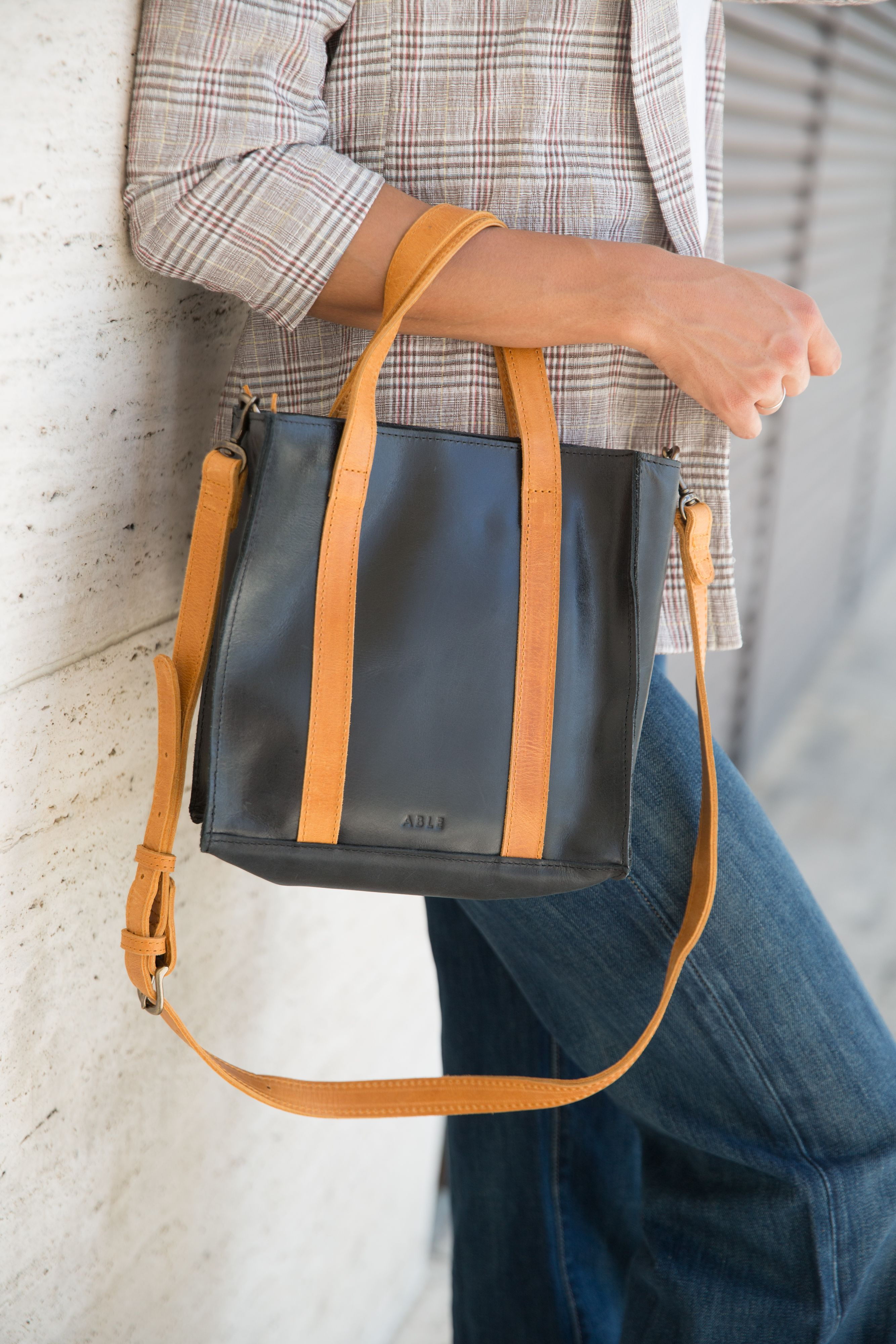 73e6898f9edd Easily wear The Elsabet Top Zip Crossbody as a handbag or attach a strap  for even more functionality. We also love that it features a top-zip  closure to ...