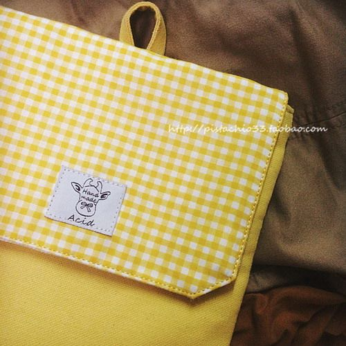 Handmade yellow sleeve with pattern in a cage for