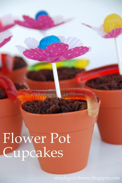 Flowerpot cupcakes with lollipop flower centers and gummy worms playing in the dirt