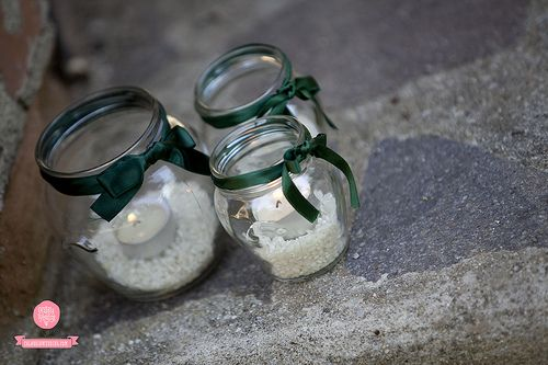Details. Simple light points idecorating the garden path. Candles and green silk ribbons in our typical glass vases. #calabriawedding #wedding #weddiinplanner #weddinginitaly  www.calabriawedding.com