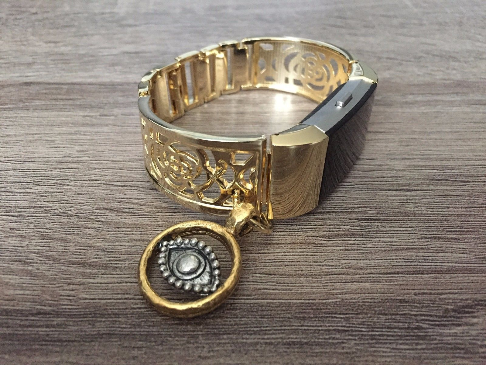 Handmade jewelry gold metal flower band with evil eye charm for