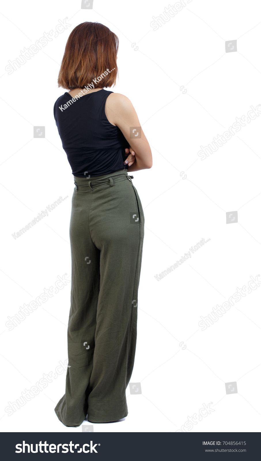 back view of standing young beautiful woman girl watching Rear