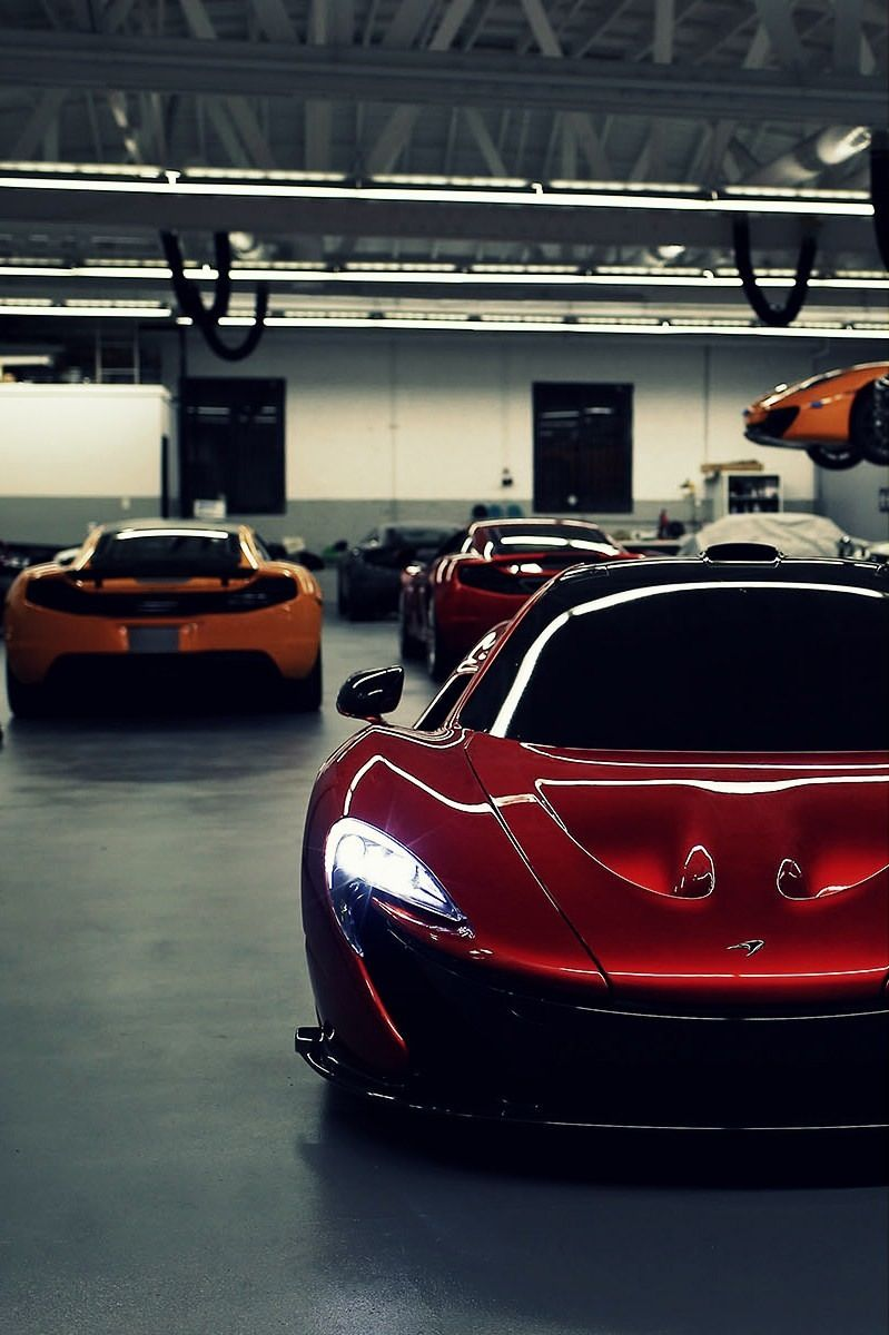 The Mclaren P1 With His Relative The Mclaren Mp412 C In The Back Sports Cars Luxury Super Cars Sport Cars