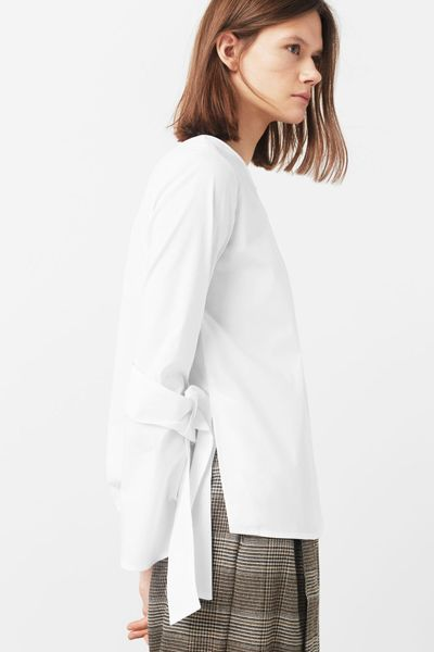 Though some trends may come and go, certain looks transcend fashion. The classic white shirt is one such piece, but this season the wardrobe staple has been elevated with with ruffles, fluted sleeves, oversized cuts, and frilled collars.   Taking its cue from high-end designers who added extravagant ruffles to otherwise conservative pieces, Zara's affordable option will see you through winter in style.